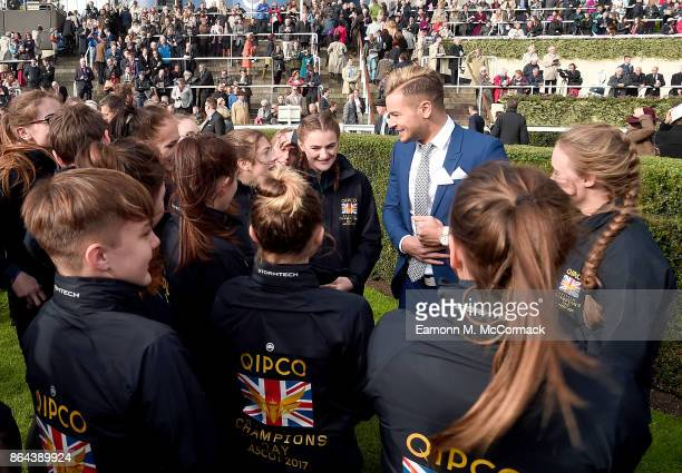 Chris Hughes meets students from the British Racing School during the QIPCO British Champions Day at Ascot Racecourse on October 21 2017 in Ascot...