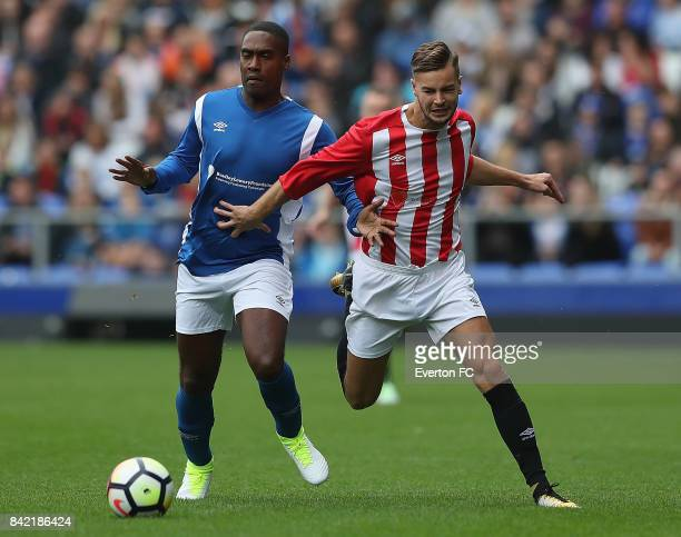 Chris Hughes of The Lowery Legends holds of Simon Webbe of Bradley's Blues during the Bradley Lowery Charity Game at Goodison Park on September 3...
