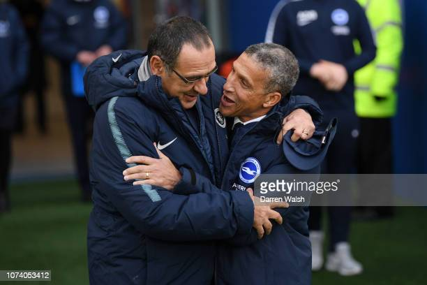 Chris Hughton Manager of Brighton and Hove Albion and Maurizio Sarri Manager of Chelsea embrace prior to the Premier League match between Brighton...