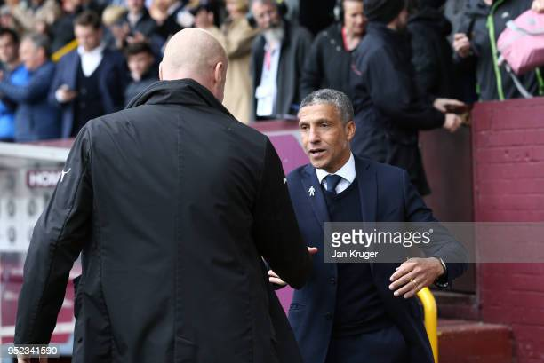 Chris Hughton Manager of Brighton and Hove Albion and Sean Dyche Manager of Burnley shake hands prior to the Premier League match between Burnley and...