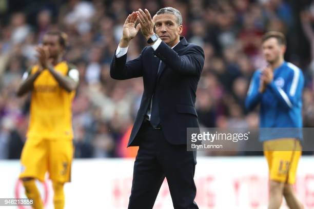 Chris Hughton Manager of Brighton and Hove Albion applauds fans after the Premier League match between Crystal Palace and Brighton and Hove Albion at...