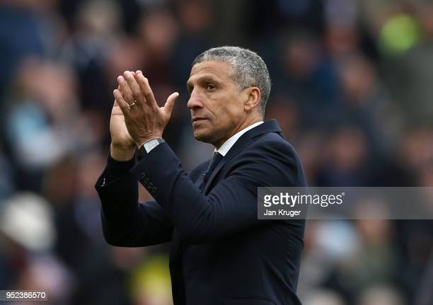 Chris Hughton Manager of Brighton and Hove Albion applauds the travellings fans after the Premier League match between Burnley and Brighton and Hove...