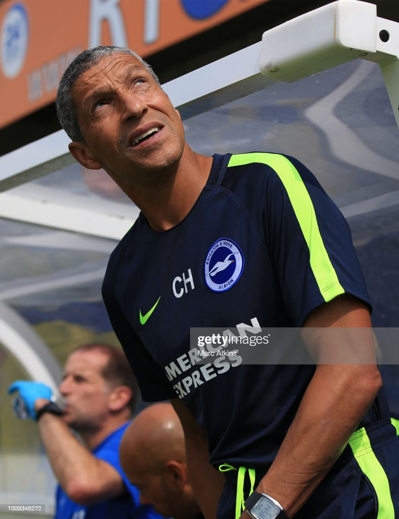 Chris Hughton manager of Brighton and Hove Albion during the pre season friendly match between AFC Wimbledon and Brighton and Hove Albion at The Cherry Red Records Stadium on July 21, 2018 in Kingston upon Thames, England.