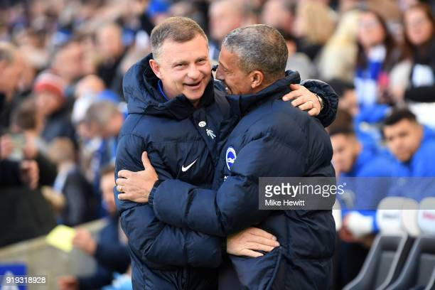 Chris Hughton Manager of Brighton and Hove Albion greets Mark Robins Manager of Coventry City prior to the The Emirates FA Cup Fifth Round between...