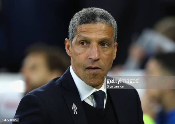 Chris Hughton Manager of Brighton and Hove Albion looks on during the Premier League match between Brighton and Hove Albion and Tottenham Hotspur at...