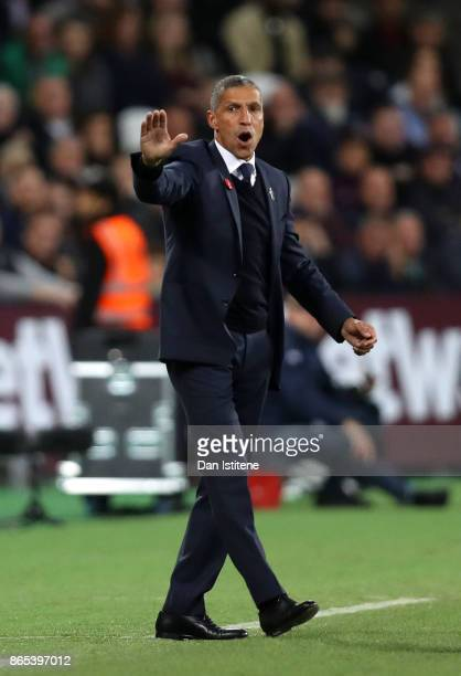 Chris Hughton manager of Brighton Hove Albion issues instructions from the touchline during the Premier League match between West Ham United and...