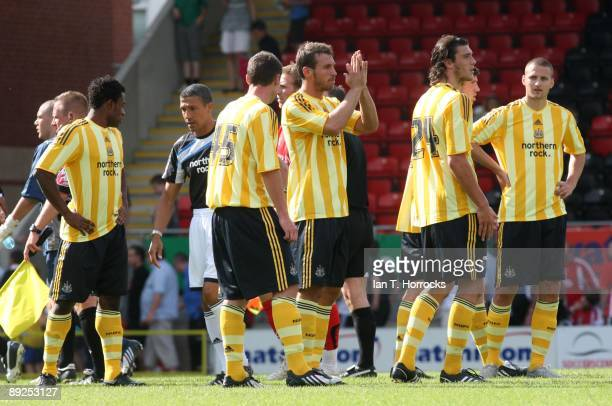Chris Hughton of Newcastle acknowledge the away fans after a pre-season friendly match between Leyton Orient and Newcastle United at the Matchroom...