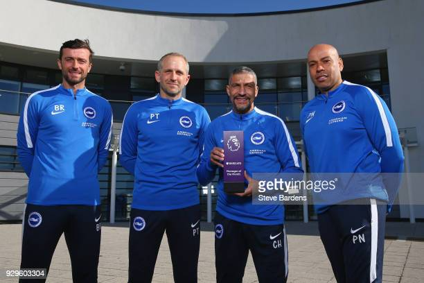 Chris Hughton the Manager of Brighton and Hove Albion and his coaching staff pose with the Barclays Manager of the Month Award for February 2018 at...