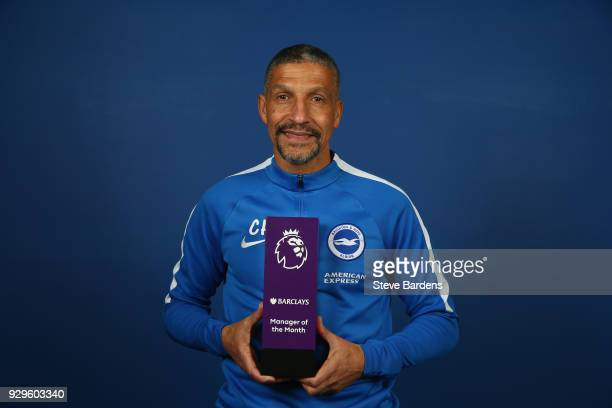 Chris Hughton the Manager of Brighton and Hove Albion poses with the Barclays Manager of the Month Award for February 2018 at the American Express...