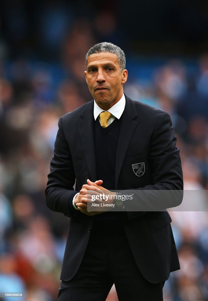 Chris Hughton the Norwich City manager applauds his sides fans following the Barclays Premier League match between Manchester City and Norwich City at Etihad Stadium on May 19, 2013 in Manchester, England.