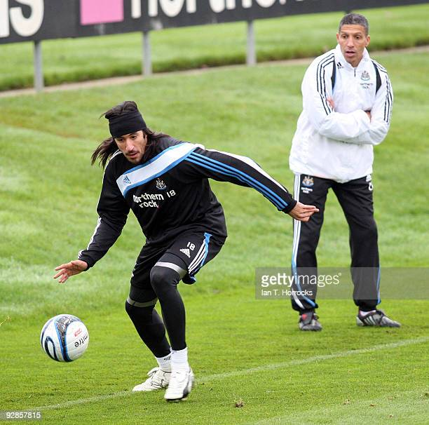 Chris Hughton watches Jonas Gutierrez during a Newcastle United training session at the Little Benton training ground on November 06 2009 in...