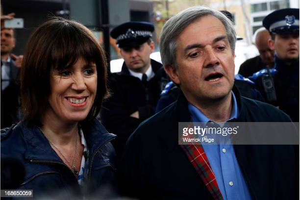 Chris Huhne faces the media with his partner Carina Trimingham as he arrives home after being released from prison on May 13 2013 in Gloucester...