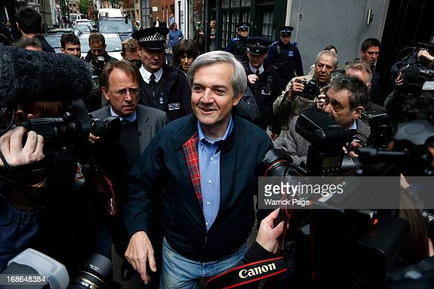 Chris Huhne is surrounded by media as he arrives home after being released from prison on May 13 2013 in Gloucester England The former energy...
