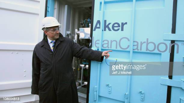 Chris Huhne Secretary of State for Energy and Climate Change views a carbon capture and storage test facility at Longannet Power Station on January...