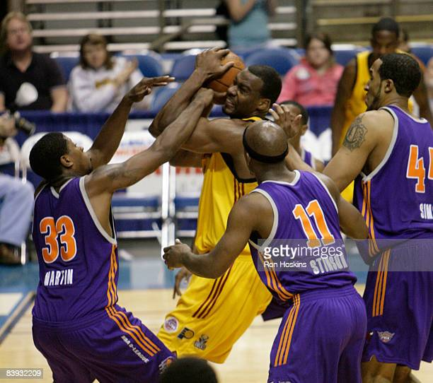 Chris Hunter of the Fort Wayne Mad Ants battles Cartier Martin and Curtis Stinson of the Iowa Energy at Allen County Memorial Coliseum on December 5...