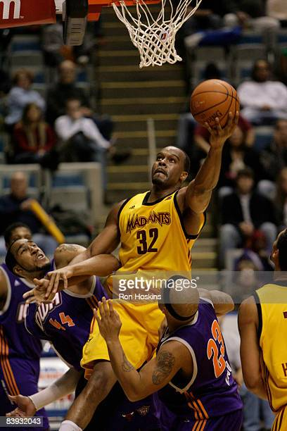 Chris Hunter of the Fort Wayne Mad Ants lays the ball up over Courtney Simms and Larry Ayuso of the Iowa Energy at Allen County Memorial Coliseum on...