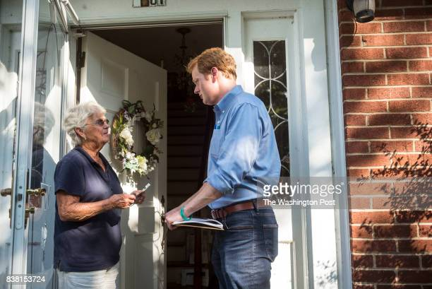Chris Hurst Democratic candidate for the VA House of Delegates speaks with Sue Elliott left while canvassing a neighborhood in his district on...