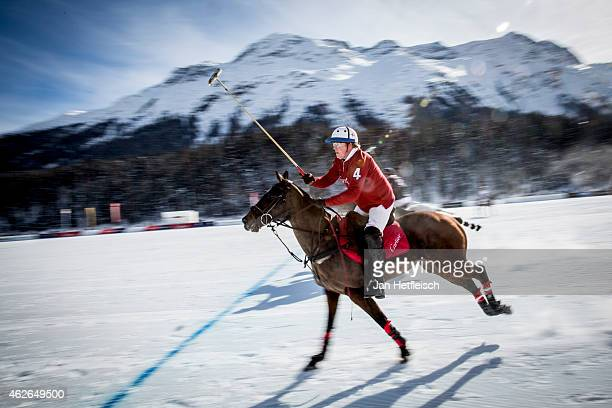 Chris Hyde from the Polo team Cartier rides on the pitch during the Snow Polo World Cup 2015 on February 1 2015 in St Moritz Switzerland