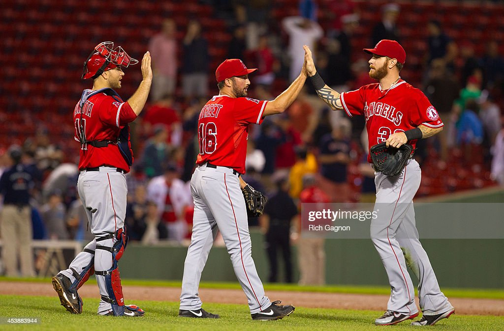 Chris Iannetta #17 and his teammates Huston Street and Josh Hamilton of the Los Angeles Angels of Anaheim celebrate a victory against the Boston Red Sox at Fenway Park on August 20, 2014 in Boston, Massachusetts.