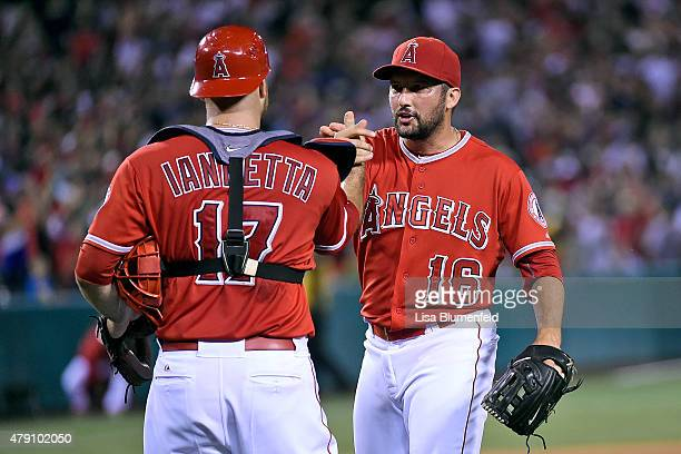 Chris Iannetta and Huston Street of the Los Angeles Angels of Anaheim celebrate defeating the New York Yankees 21 at Angel Stadium of Anaheim on June...