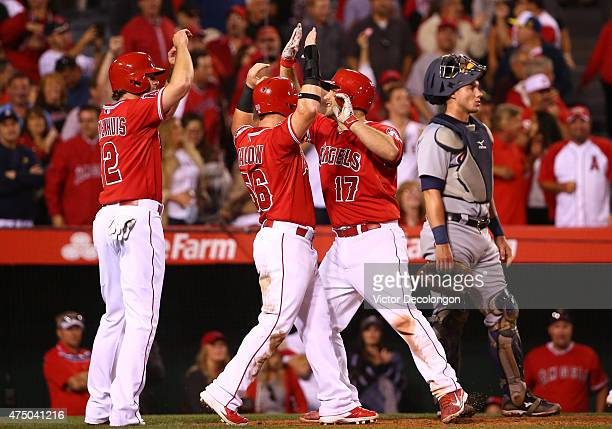 Chris Iannetta celebrates with teammates Kole Calhoun and Kirk Nieuwenhuis after hitting a grand slam in the seventh inning as catcher James McCann...