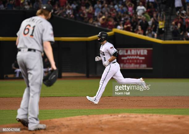 Chris Iannetta of the Arizona Diamondbacks rounds the bases after hitting a three run home run off of Adam Conley of the Miami Marlins during the...