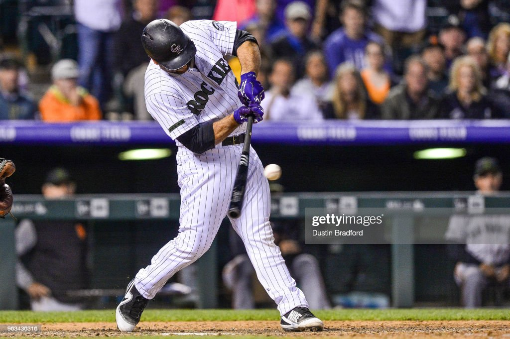 Chris Iannetta #22 of the Colorado Rockies hits a 10th inning bases-loaded single for a walk-off RBI against the San Francisco Giants at Coors Field on May 28, 2018 in Denver, Colorado.
