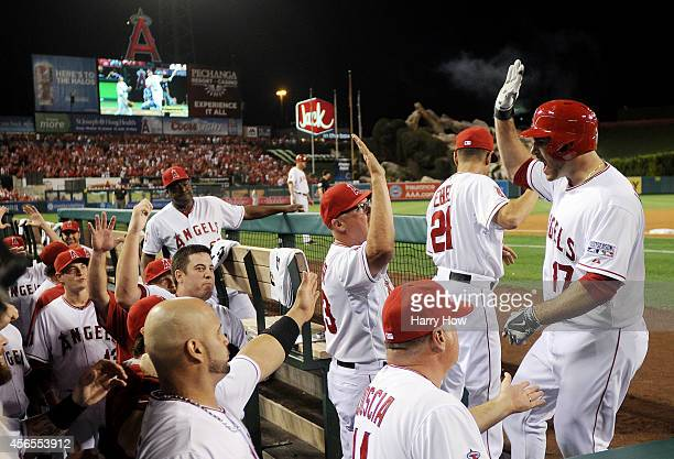 Chris Iannetta of the Los Angeles Angels returns to the dugout after hitting a home run in the third inning against the Kansas City Royals during...