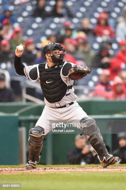 Chris Iannette of the Colorado Rockies throws to second base during a baseball game against the Washington Nationals at Nationals Park on April 15...