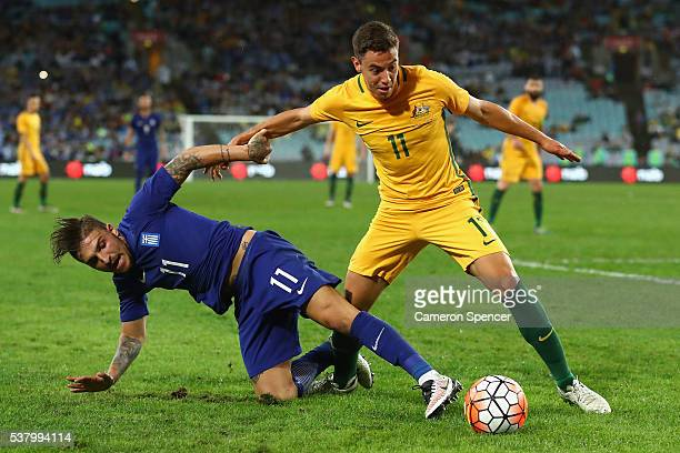 Chris Ikonomidis of the Socceroos and Kostas Stafylidis of Greece contest the ball during the international friendly match between the Australian...