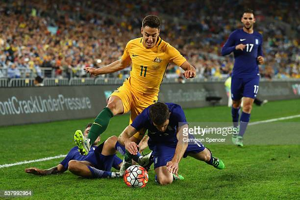 Chris Ikonomidis of the Socceroos is tackled by Sokratis Papastathopoulos of Greece during the international friendly match between the Australian...