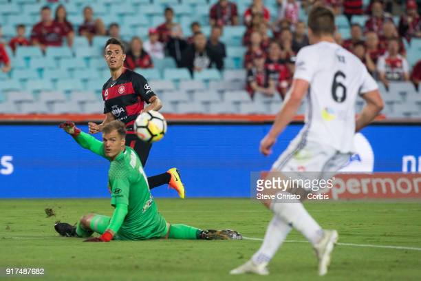 Chris Ikonomidis of the Wanderers chips the ball past Phoenix's goalkeeper Lewis Italiano during the round seven ALeague match between the Western...