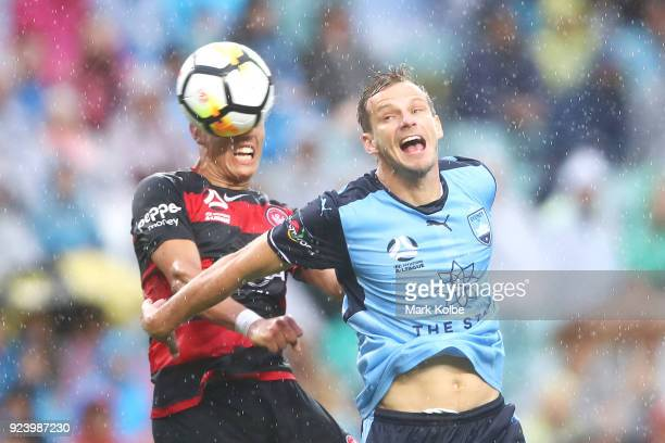 Chris Ikonomidis of the Wanderers heads at goal under pressure from Alex Wilkinson of Sydney FC during the round 21 ALeague match between Sydney FC...