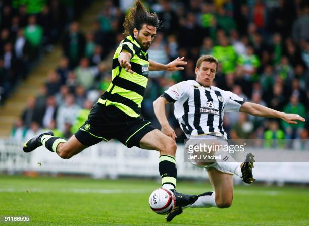 Chris Innes of St Mirren tackles Georgios Samaras of Celtic during the Clydesdale Bank Scottish Premier league match between St Mirren and Celtic at...