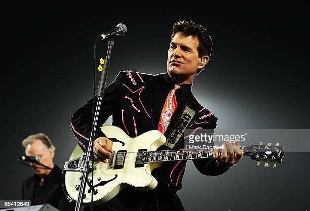 Chris Isaak performs at the half time break of the round one NRL match between the Melbourne Storm and the St George Illawarra Dragons at Olympic...