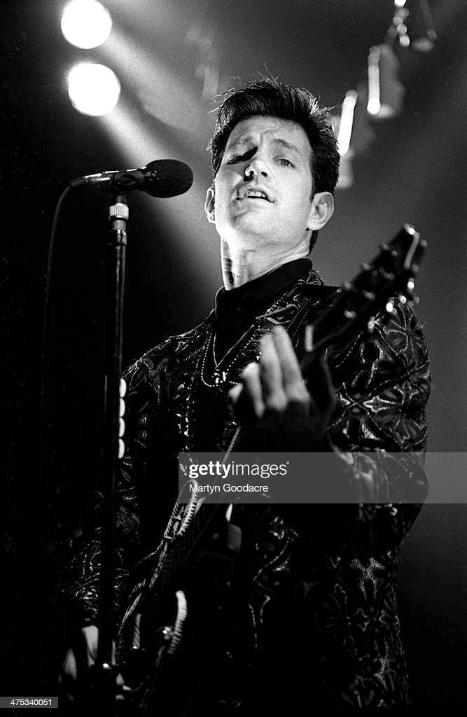 chris isaak performs on stage with at the town and country kentish news photo getty images. Black Bedroom Furniture Sets. Home Design Ideas