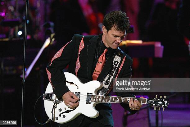 Chris Isaak performs on the Concert for America at the Kennedy Center in washington DC September 9 2002 The show airs on NBC on Wednesday September...