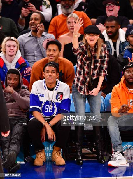 Chris Ivery and Ellen Pompeo attend the Brooklyn Nets v New York Knicks game at Madison Square Garden on November 24 2019 in New York City