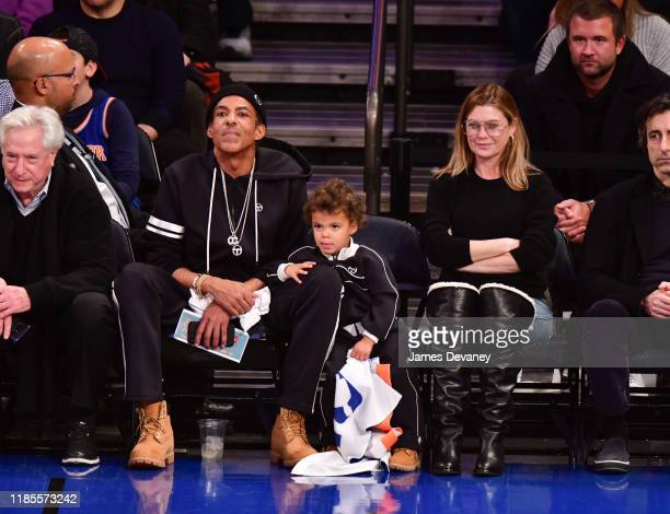 Chris Ivery Eli Ivery and Ellen Pompeo attend the Brooklyn Nets v New York Knicks game at Madison Square Garden on November 24 2019 in New York City