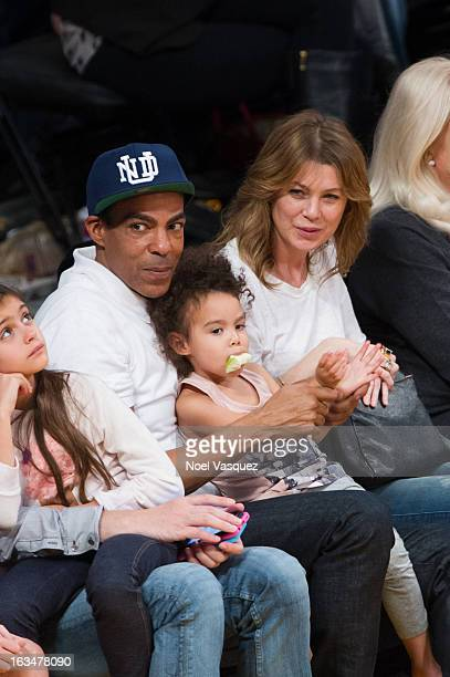 Chris Ivery his daughter Stella Luna Ivery and wife Ellen Pompeo attend a basketball game between the Chicago Bulls and Los Angeles Lakers at Staples...
