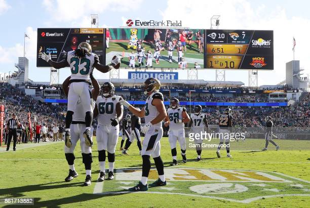 Chris Ivory of the Jacksonville Jaguars celebrates with his teammates after a 22yard touchdown in the first half of their game against the Los...