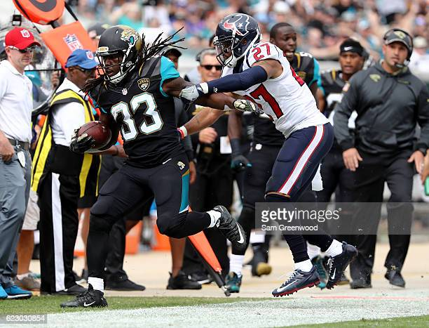 Chris Ivory of the Jacksonville Jaguars is pushed out of bounds by Quintin Demps of the Houston Texans during the game at EverBank Field on November...