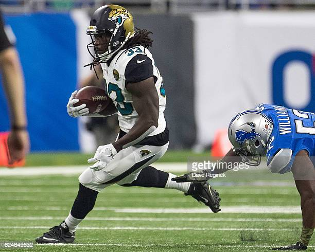 Chris Ivory of the Jacksonville Jaguars runs the ball in front of Antwione Williams of the Detroit Lions during an NFL game at Ford Field on November...