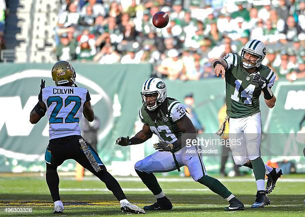 Chris Ivory of the New York Jets blocks Aaron Colvin of the Jacksonville Jaguars as Ryan Fitzpatrick of the New York Jets attempts a pass during the...
