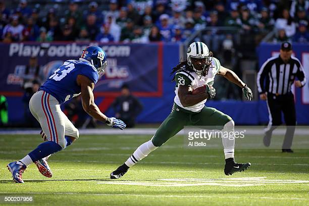 Chris Ivory of the New York Jets runs with the ball against Jasper Brinkley of the New York Giants at MetLife Stadium on December 6 2015 in East...