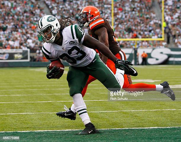 Chris Ivory of the New York Jets scores a touchdown as Donte Whitner of the Cleveland Browns chases during the third quarter of a game at MetLife...
