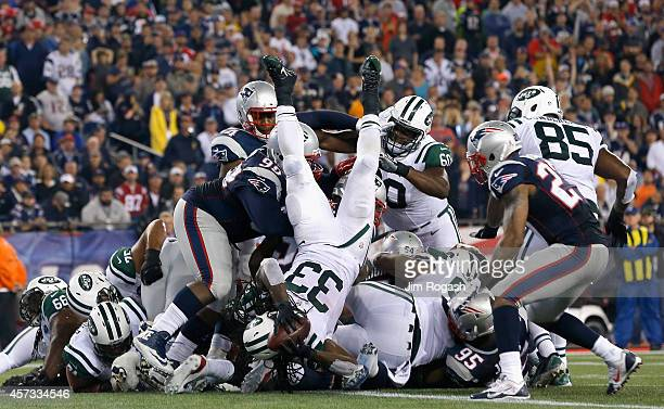 Chris Ivory of the New York Jets scores a touchdown during the third quarter against the New England Patriots at Gillette Stadium on October 16 2014...