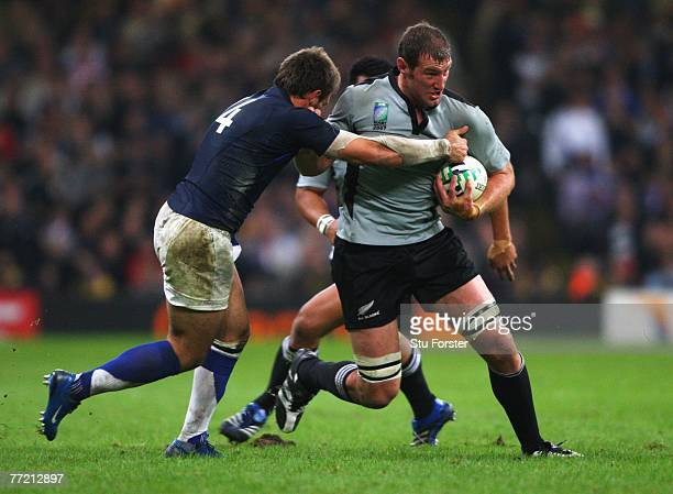 Chris Jack of New Zealand takes on Vincent Clerc of France during the Quarter Final of the Rugby World Cup 2007 match between New Zealand and France...