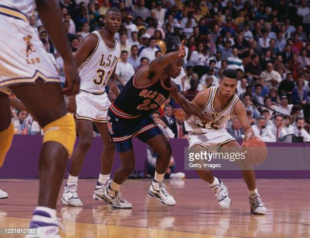 Chris Jackson Guard for the Louisiana State University Fighting Tigers dribbles the ball past Tim Jumper Guard for the University of Mississippi Ole...