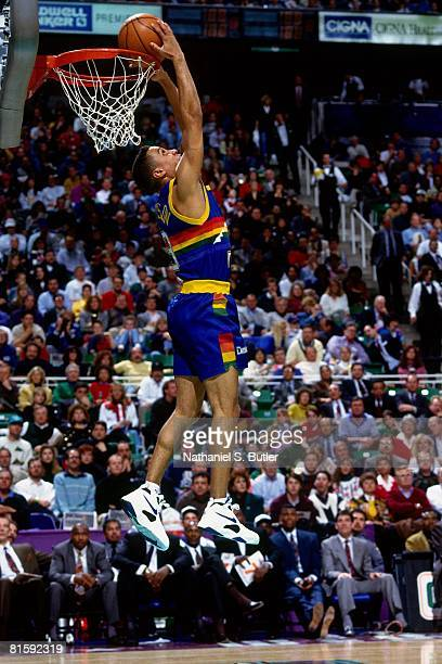 Chris Jackson of the Denver Nuggets attempts a dunk during the 1993 NBA Slam Dunk Contest on February 20 at the Delta Center in Salt Lake City Utah...